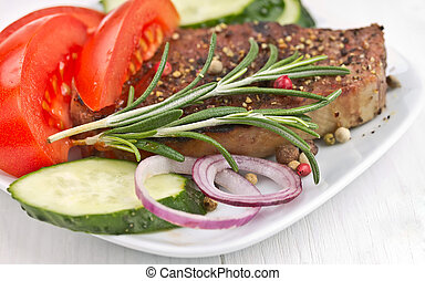 Grilled Steak Meat  with vegetables.