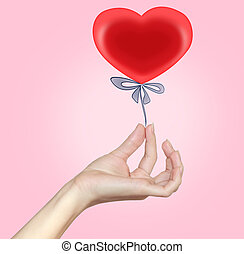 Woman hand holding heart gift with blue ribbon. Red bright love present isolated on pink background