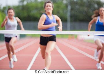 Athletes close to finish line - Female athletes close to...