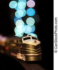 Miniature train on a christmas lights bokeh background