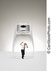 Senior businessman trapped under a glass - Conceptual studio...