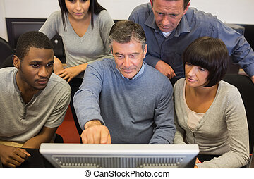 Man pointing out something on computer monitor