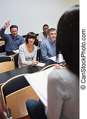 Man asking question in lecture in college