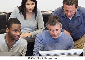 People looking at computer monitor