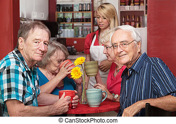 Mature Cafe Patrons - Cheerful group of senior citizens in...