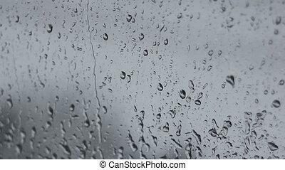 Rain drops, two shots - Rain drops on window glass, two...