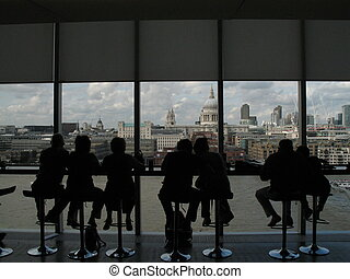 people silhouettes at the bar in the art gallery with a...