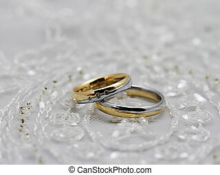Wedding rings, pearls and tulle fabric
