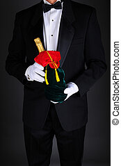 Man With Champagne Bottle in Gift Bag - Gentleman wearing a...