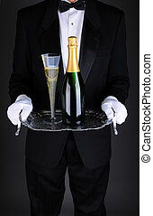 Waiter with Champagne on Tray - Closeup of a waiter with a...