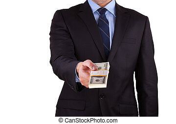 businessman holding large sum of cash - A businessman's hand...