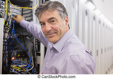Technician changing cables in the server case - Technician...