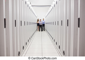 People standing in corridor of data center