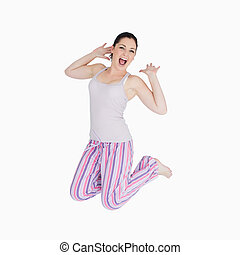 Yawning woman in pajamas - Yawning and stretching woman in...
