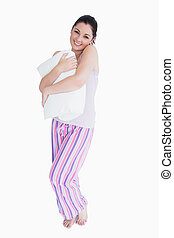 Smiling woman holding a pillow