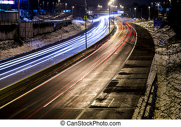 Night traffic lights on a highway in European city...