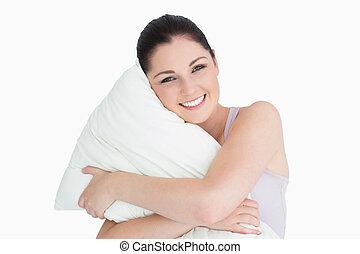 sonriente, mujer, tenencia, almohada, contra, blanco, Plano...