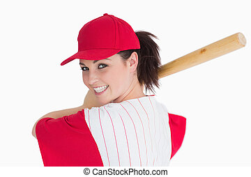 Woman ready to play with baseball bat