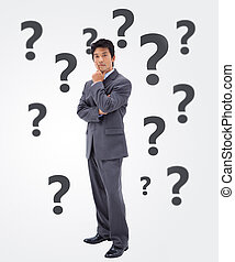 Undecided businessman on white background with black...
