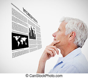 Man reading holographic world news against white background