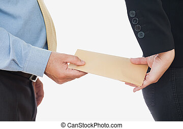 Businessman exchanging bribe with female coworker - Close-up...