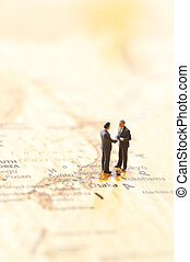 businessman figurines and world map - miniature businessman...