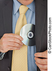 Businessman putting CD in his pocket - Close-up of...