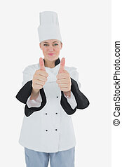Chef showing thumbs up sign - Portrait of female chef...