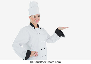Female chef holding out your product