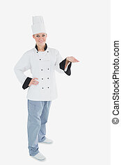 Portrait of female chef holding invisible product - Full...