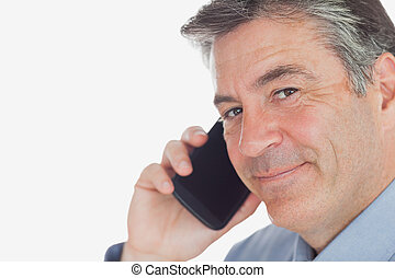 Mature businessman using cell phone