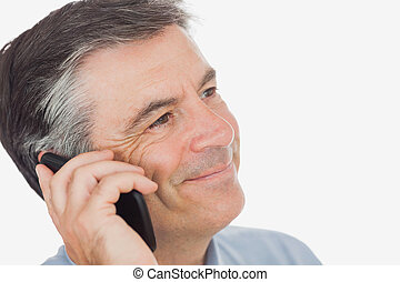 Businessman smiling while using mobile phone