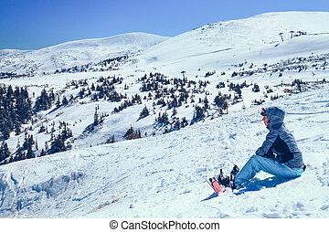 snowboarder girl - young snowboarder girl in winter clothes...
