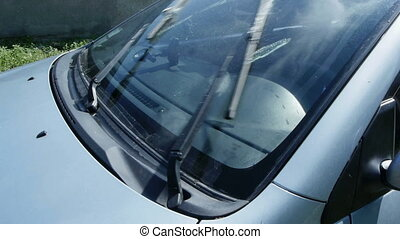 Cleaning the windscreen with wipers