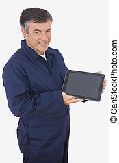 Mechanic displaying digital tablet - Portrait of mature...