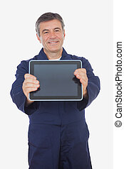 Mature mechanic displaying digital tablet - Portrait of...