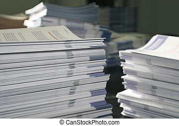 Handout Paper Piles - Piles of handout papers lying on a...