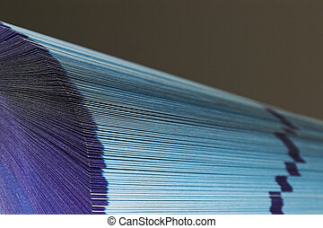 Fanned pages - 1 - The cutting face of a phone directory...