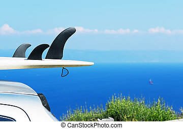 Fins - detail of surfboard fins with blue sea on the...