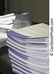 Piles of handout papers lying on a table