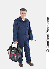 Mechanic carrying tool bag - Portrait of mature mechanic...