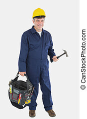 Technician wearing hardhat while carrying tool bag