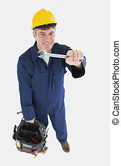 Technician with wrench carrying tool bag