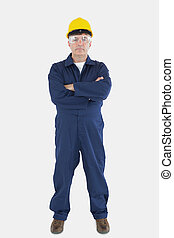 Confident technician wearing hardhat and eyewear - Full...