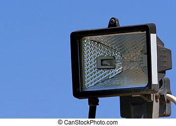 floodlight - detail of a floodlight under a blue sky