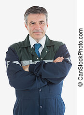 Portrait of confident repairman with arms crossed - Portrait...