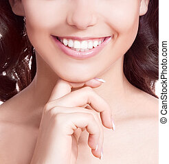 teeth of a woman - closeup of the healthy white teeth of a...