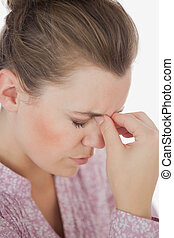 Woman suffering from headache - Close-up of woman suffering...
