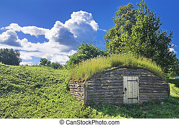 Ancient earth house near medieval Russian fortress