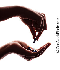 hands with pills - hands of a woman holding pills, isolated...